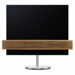 """B&O Eclipse 65"""" oak cover on motorised floor stand"""